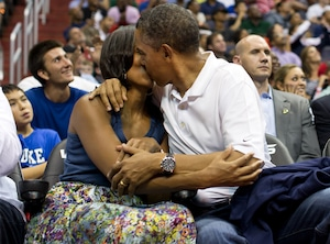 Kiss Cam Couples, Barack Obama kisses First Lady Michelle Obama