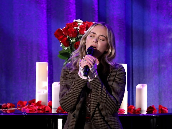Watch Emily Blunt Beg For Chris Martin's Forgiveness With An Epic Song