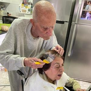 Elderly husband colors wife's hair so she feel well groomed