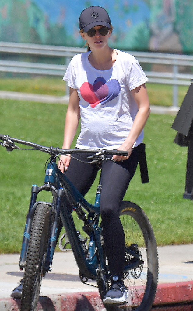 Katherine Schwarzenegger Debuts Her Baby Bump Alongside Chris Pratt During Bike Ride