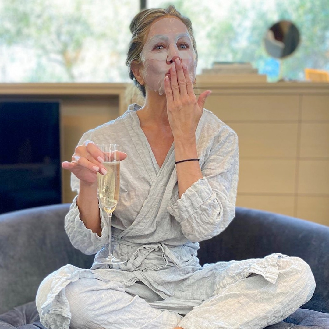 Jennifer Aniston Nails Her 2020 Emmys Prep With Her ''Other'' Mask and Champagne