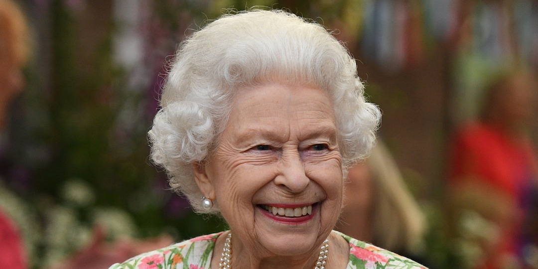 See Queen Elizabeth II Happily Wield a Sword to Cut Cake at G7 Summit Event - E! Online.jpg