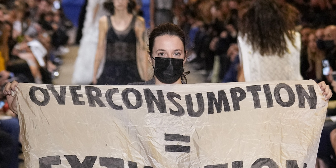 See a Protester Disrupt Louis Vuitton's Runway Show During Paris Fashion Week - E! Online.jpg