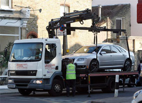 Kylie's car being towed